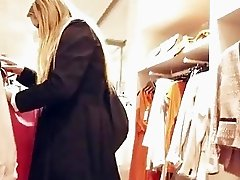 Blonde chick gives head in changingroom