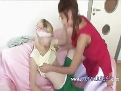 Natasha and Alice using strapon for sex