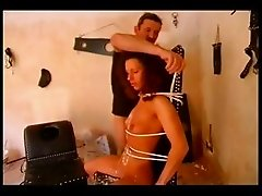 Dominant couple punishing a slave girl