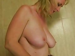 Two guys fucking and pissing on sexy mature lady