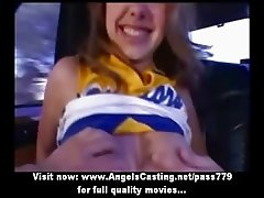 Stunning redhead cheerleader teen doing blowjob on the car