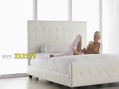 Blonde pornstar Emma in pink lingerie