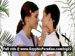 Lovely brunette lesbians kising and licking nipples and having lesbian love