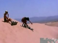 Three hot babes taking off bikinis and try out sandboarding