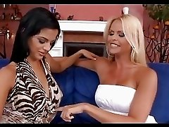 Gitta Szoke and Black Angelica fuck each others tight twats with a strap on cock