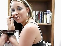 Hot blonde chick fingers her cunt in the library