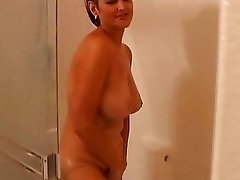Big tits mature amateur gets wet