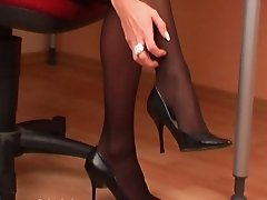 Sexy secretary in black pantyhose