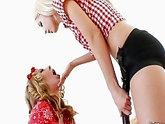 Hot lesbians having fun with the strapon
