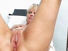 Hot mature blonde lady gets her pussy examined at gyno clinic