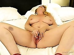 Curvy mom in high heels plays with a new vibrator