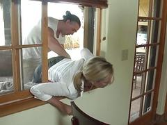 A blonde mommy is fucked in the window super hard