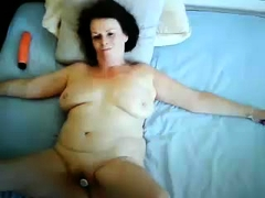 Horny mature wife with big boobs gets pleased with a sex toy