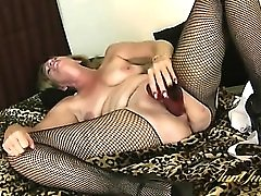 Huge red dildo fucks deep into her mature pussy