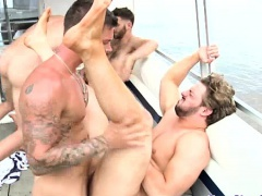 Orgy enjoying muscled hunk hot boat orgy