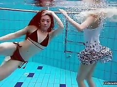 Cute girls swim together and strip each other naked