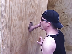 Guy gives BJ via glory hole