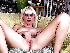 Blonde Marie McCray masturbates on the couch