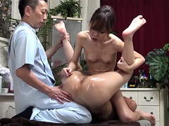 Lovely Japanese babes getting banged on the massage table