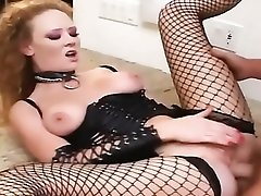 Redhead has sex in leather and fishnet stockings