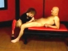 Kinky redhead milf puts her big tits on display and blows a long dick