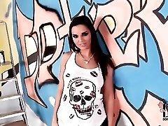 Eve Angel spray paint artist shows ass