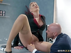 Bodacious blonde woman, Ryan Keely is getting fucked on her working desk, during a lunch break