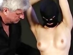 Masked slave stripped and tied up by BDSM fuck master