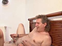 German blonde milf taking two cocks