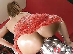 Japanese girl soaked in lube and fucking a toy