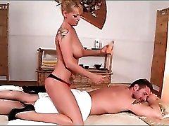 Big titty blonde gives a sexy body massage