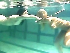Underwater girls play with a hula hoop