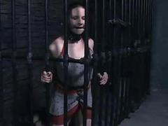 Caged whore begs for help in the dungeon BDSM porn