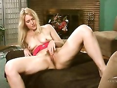 Solo blonde milf Trish in red lace lingerie