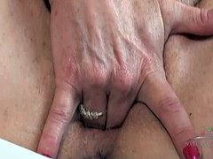 Amateur blonde MILF playing with her dripping tunnel of love