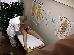 Delightful Oriental girl has a masseur making her cunt happy