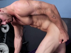 Muscled Chuck tugs his thick cock