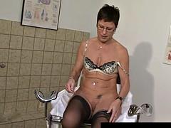 German milf masturbates her pussy