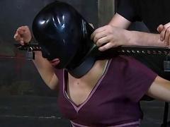 Bound babe gets rubber mask on her face BDSM porn