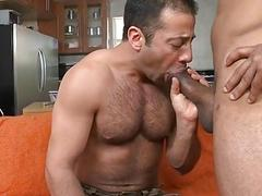 Buff body builder engulfing massive monster rod