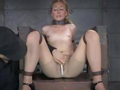 Bondage slave girl squirts with help of fuck machines BDSM