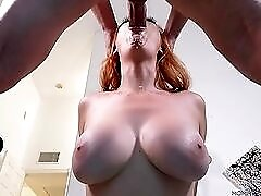 Buxom milf redhead on her knees to eat cock