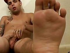 Inked foot fetish straighty plays with his cock and cums