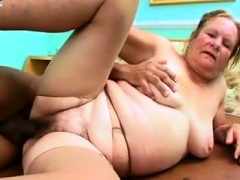 Lustful granny has a black stud drilling her hairy beaver