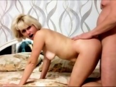 Sexy Blonde cougar Eating a young dick