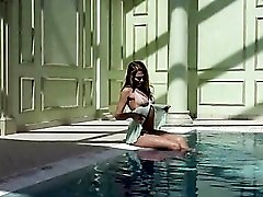Teen in lingerie goes for a swim in the pool