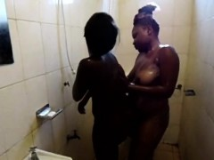 Chunky African babe fucks a slim honey in the shower