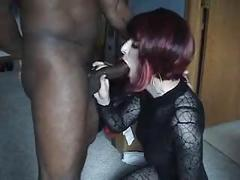 Shemale slut on her knees sucking BBC