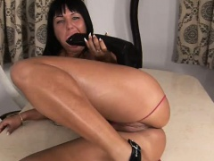 Slut climaxes as she masturbates with big dildo