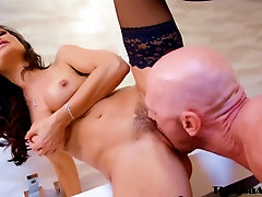 Excellent looking mature lady, Lisa Ann enjoys the way Johnny Sins is penetrating her brains out